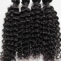 natural curly weft machine made 100grms (3.5 Oz.)pc.